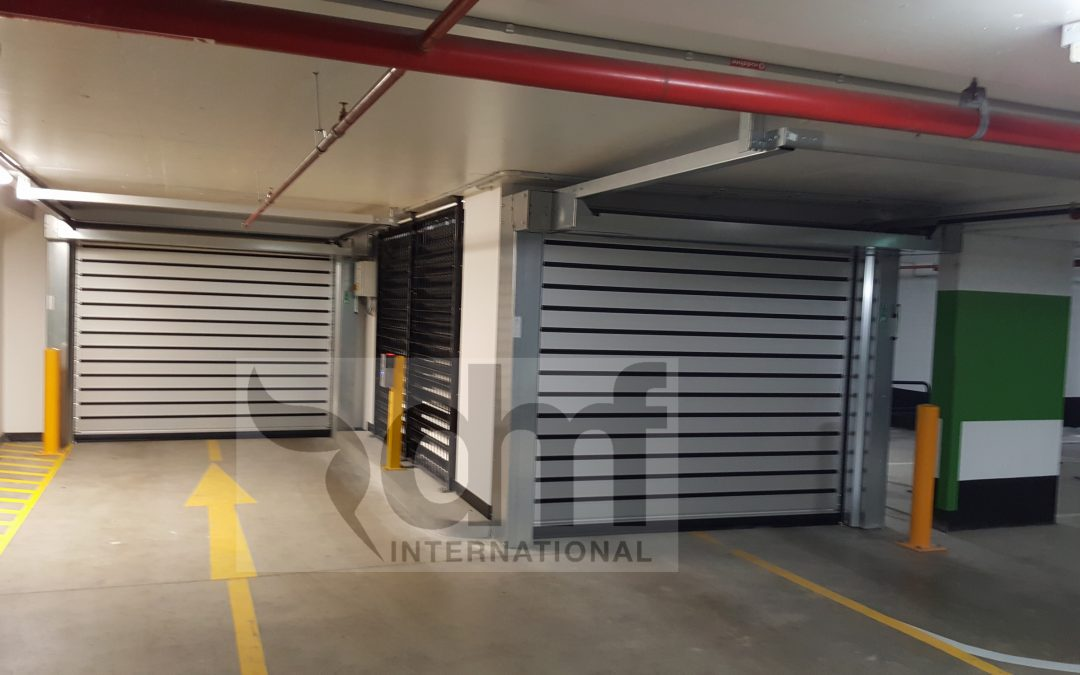 High speed carpark doors for low head room applications