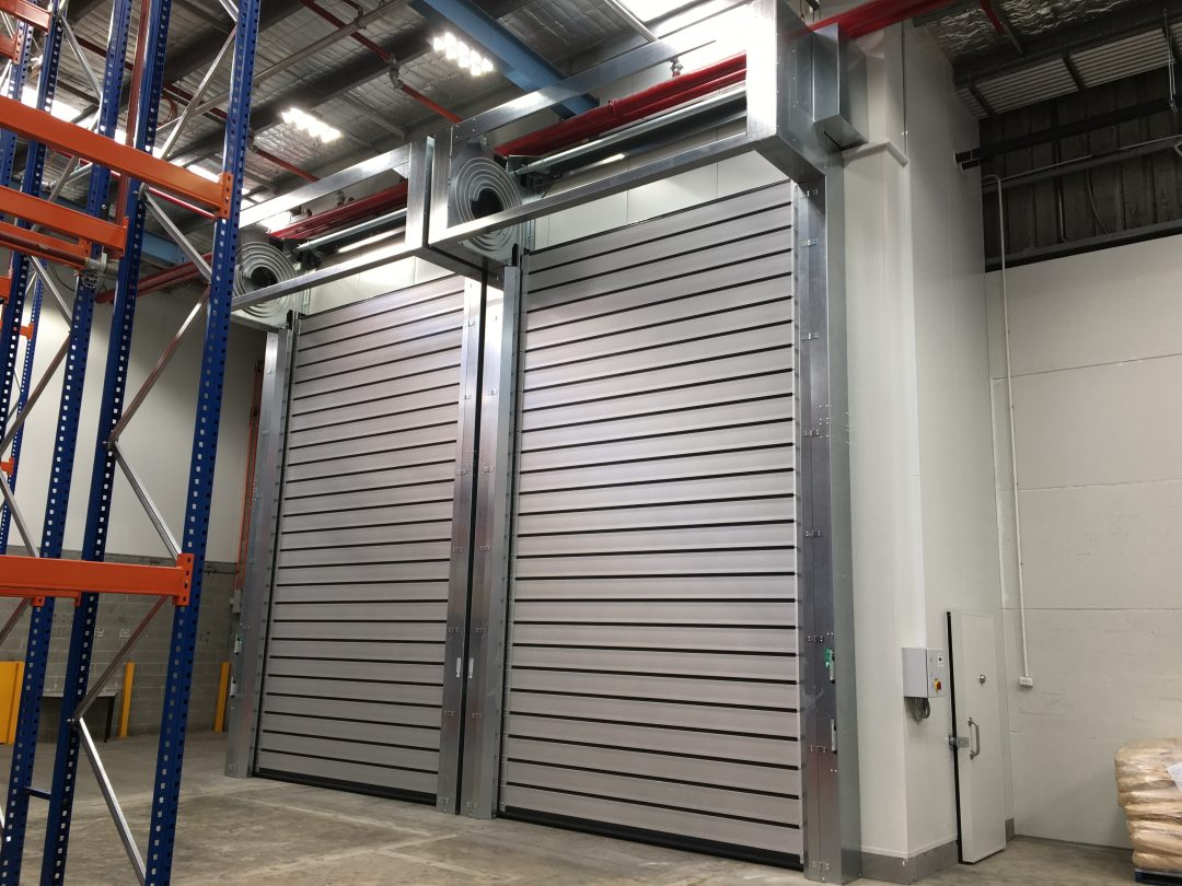 Insulated roll doors for chiller enclosures